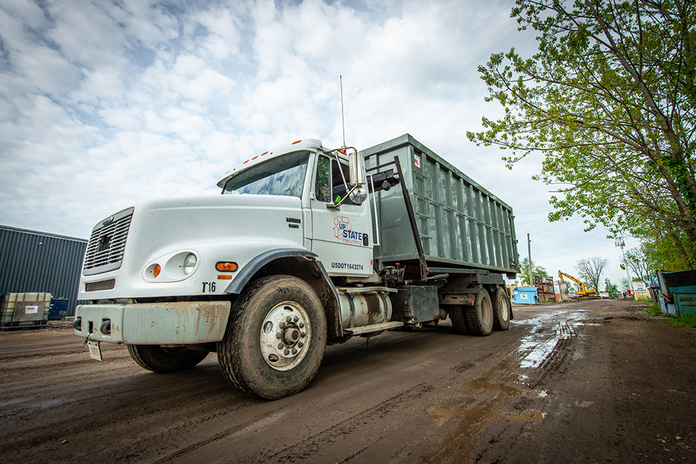 We are equipped with several roll-off and day cab tractors if your project requires scrap containers.